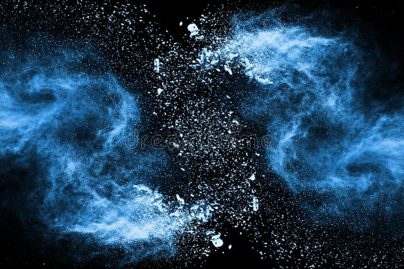 Blue color powder explosion on black background. royalty free stock photos