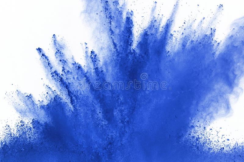 Abstract blue powder splatted background,Freeze motion of color powder exploding/throwing color powder,color glitter texture on wh. Ite background royalty free stock photography