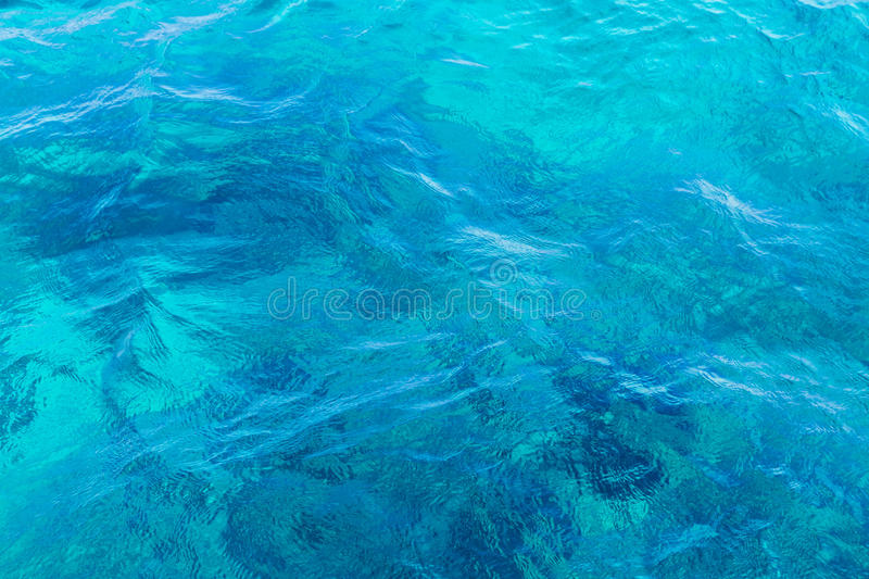 Abstract blue sea water surface. Reflection background stock photo