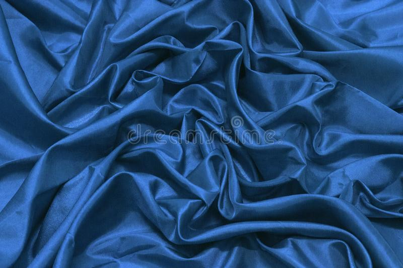 Abstract blue silk or satin luxury cloth texture can use as wedding background. Luxurious Christmas or New Year background design. royalty free stock photos