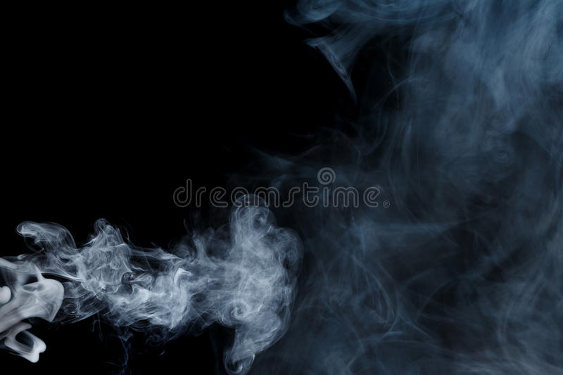Abstract blue smoke Weipa. Abstract smoke Weipa. Personal vaporizers fragrant steam. The concept of alternative non-nicotine smoking. Blue smoke on a black stock photos