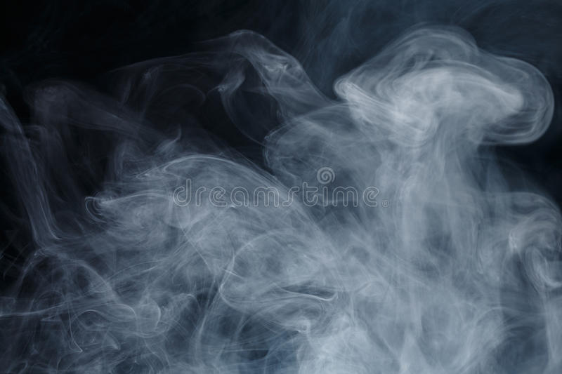 Abstract blue smoke Weipa. Abstract smoke Weipa. Personal vaporizers fragrant steam. The concept of alternative non-nicotine smoking. Blue smoke on a black stock images