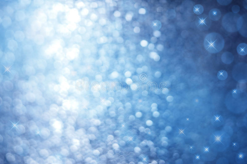 Abstract Blue Sparkle Christmas Background. An abstract blue background with sparkle lights and stars royalty free stock photo