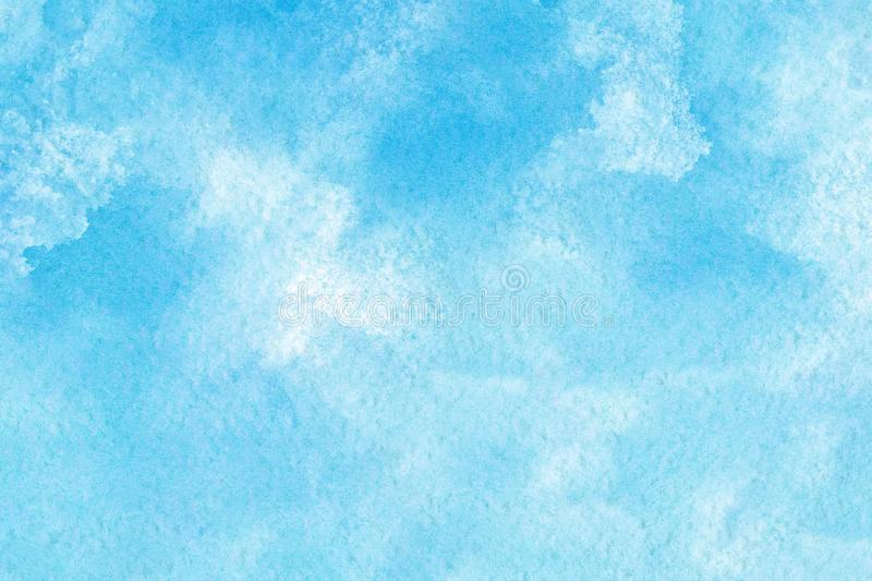 Abstract blue watercolor on white background.The color splashing in the paper.It is a hand drawn stock photos