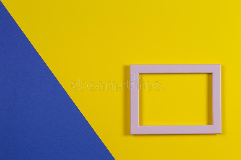 Abstract blue and yellow paper background with empty picture frame royalty free stock photography