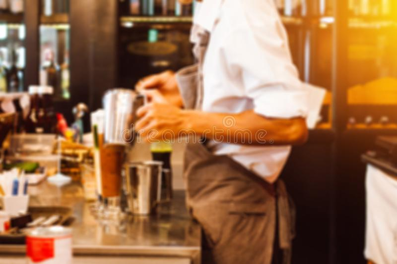 Abstract blur background of barista for coffee shop business background. Barista cafe coffee grinder pour professional concept. royalty free stock photo
