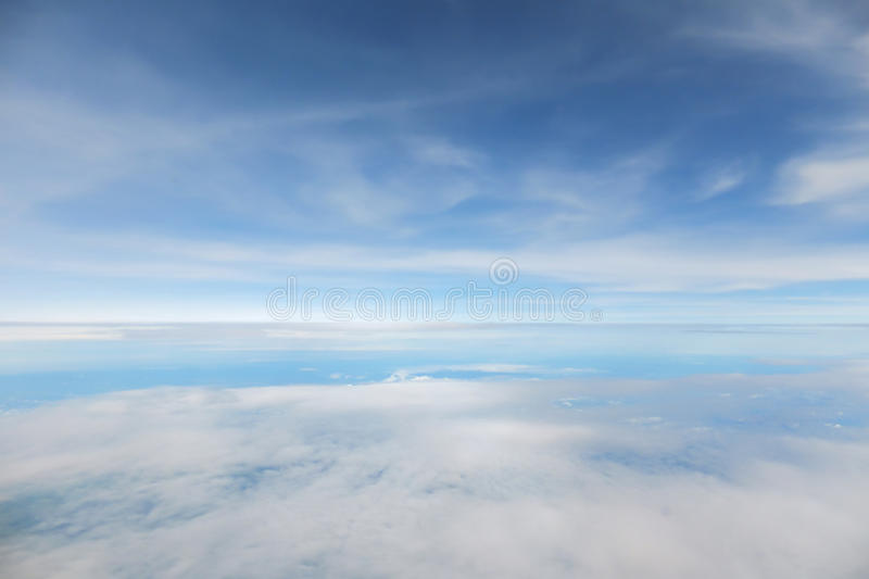 Abstract and blur background of blue sky. Abstract and blur background of blue sky and cloudy in window view of air plane. Color blue tone royalty free stock photography
