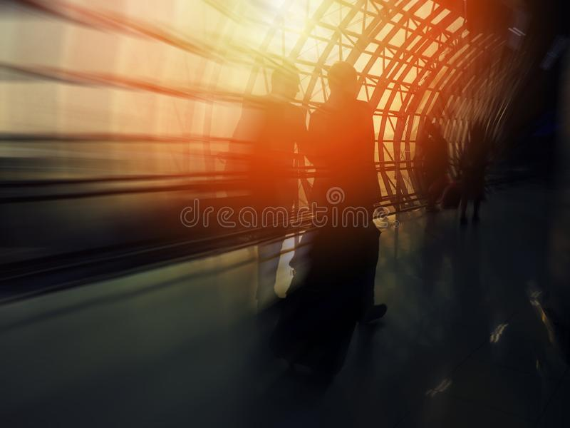 Abstract blur background silhouette people walking on the path at the airport royalty free stock photo