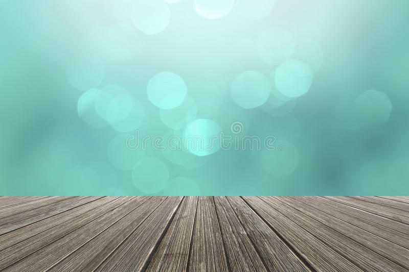 Abstract blur bokeh background and wood floor as a background royalty free stock photos