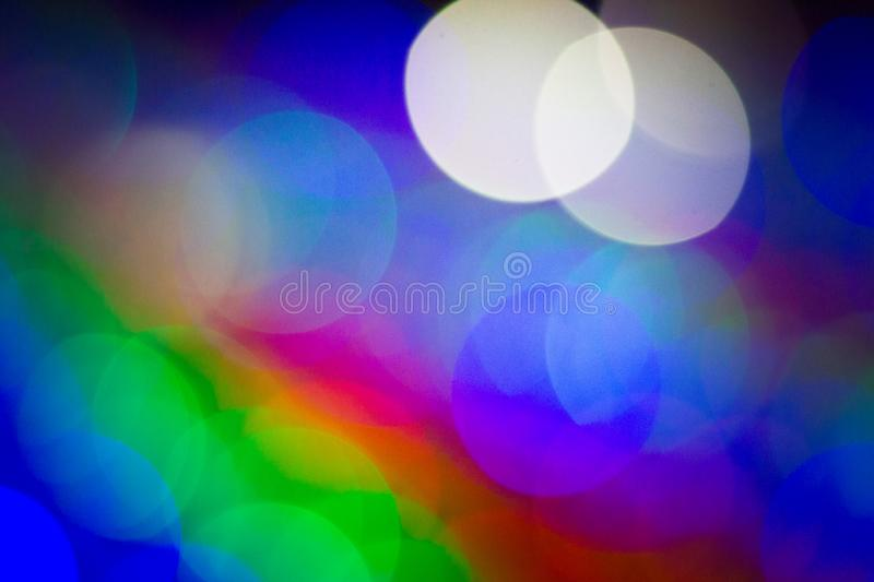 Abstract blur bokeh circles use it to texture background. Colorful lights with abstract blur bokeh circles use it to texture background in Happy new year or stock images