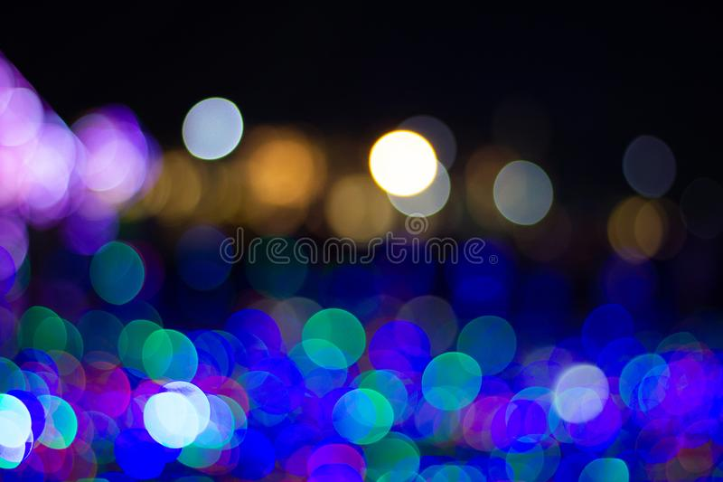 Abstract blur bokeh circles use it to texture background. Colorful lights with abstract blur bokeh circles use it to texture background in Happy new year or royalty free stock image