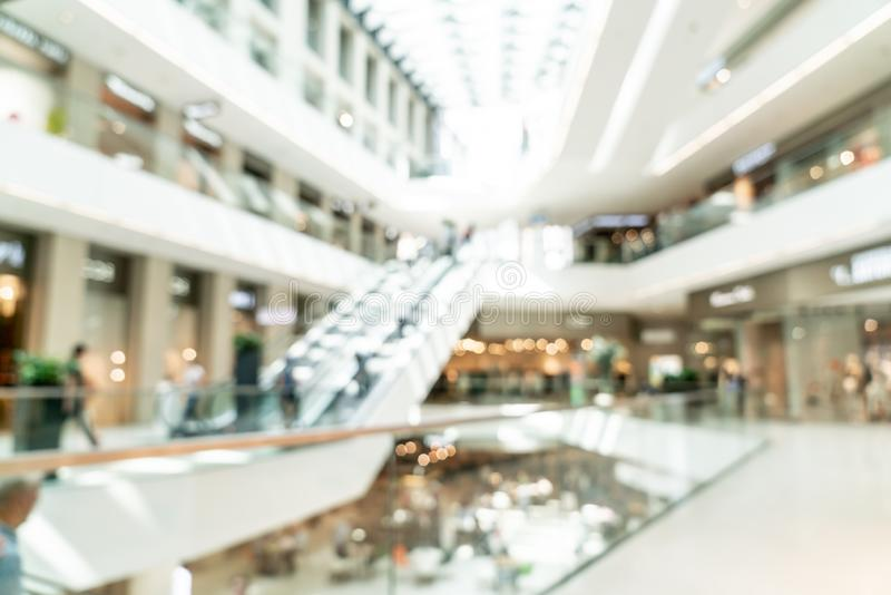 Abstract blur with bokeh and defocused shopping mall in deparment store. For background royalty free stock image
