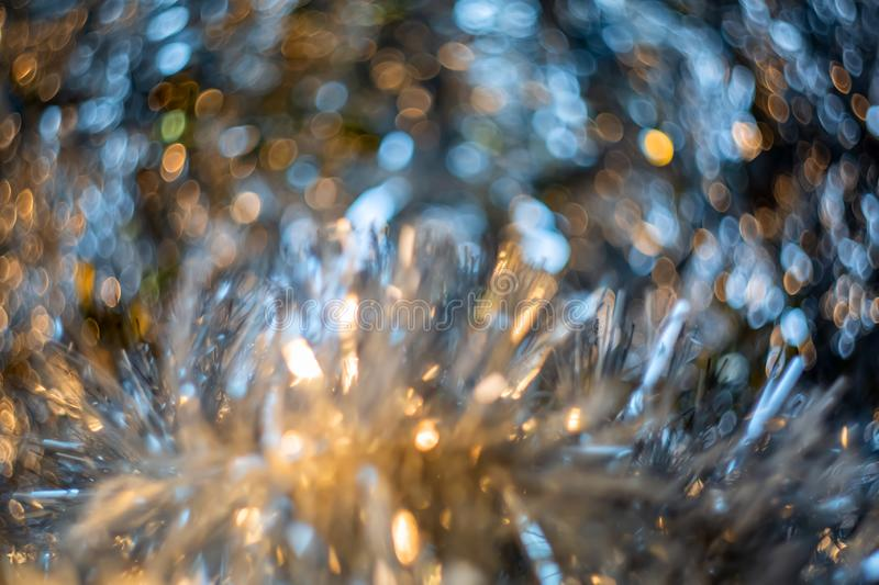 Abstract blur and defocused crumpled gray foil texture for background. Artistic colorful bokeh. Toned image stock image
