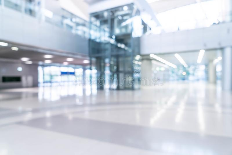 abstract blur and defocused in empty office building with glass stock image