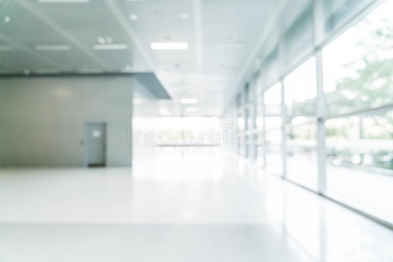 abstract blur and defocused in empty office building with glass royalty free stock image