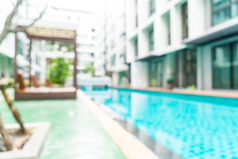 Abstract blur and defocused swimming pool in hotel resort. For background stock images