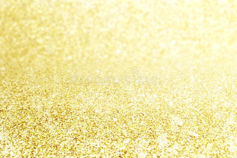 Abstract blur gold glitter christmas event celebration card design background concept - shiny light dust sparkle festive stock image