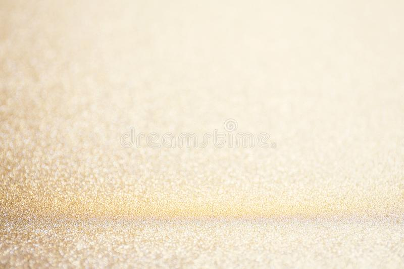 Abstract blur gold glitter christmas event celebration card design background concept - shiny light dust sparkle festive royalty free stock photography