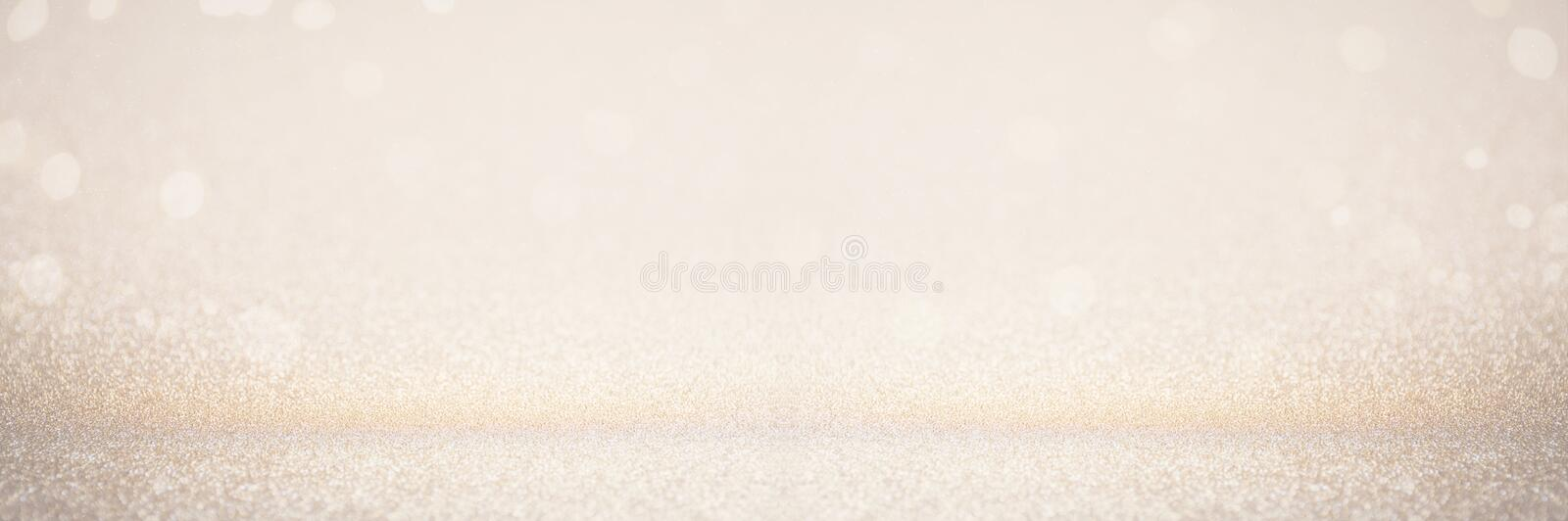 Abstract blur gold glitter christmas event celebration card design wide screen background concept - shiny golden light dust. Sparkle festive decoration effect stock photography