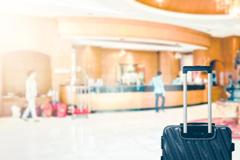 Abstract Blur hotel lobby with receptionist and luggage bag for background.  royalty free stock images