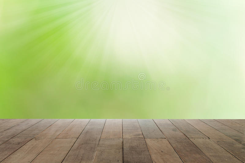 Abstract blur nature background with wooden floor. Green abstract blur nature background with wooden floor royalty free stock images