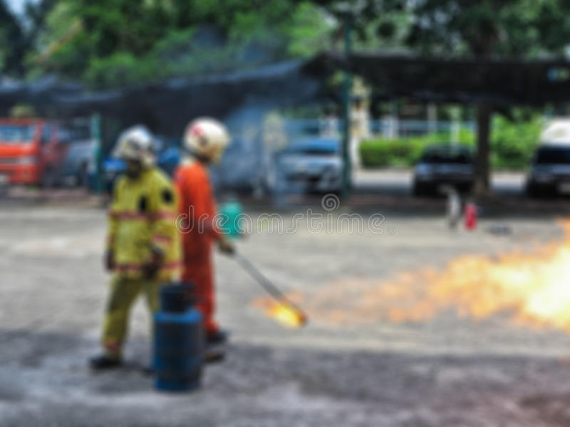 Abstract blur people practicing how to stop fire in fire fighting training course. Safety first. Abstract blur people practicing how to stop fire in fire royalty free stock photos