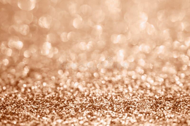 Blur rose gold glitter sparkle defocused bokeh light background. Abstract blur rose gold glitter sparkle defocused bokeh light background stock photo