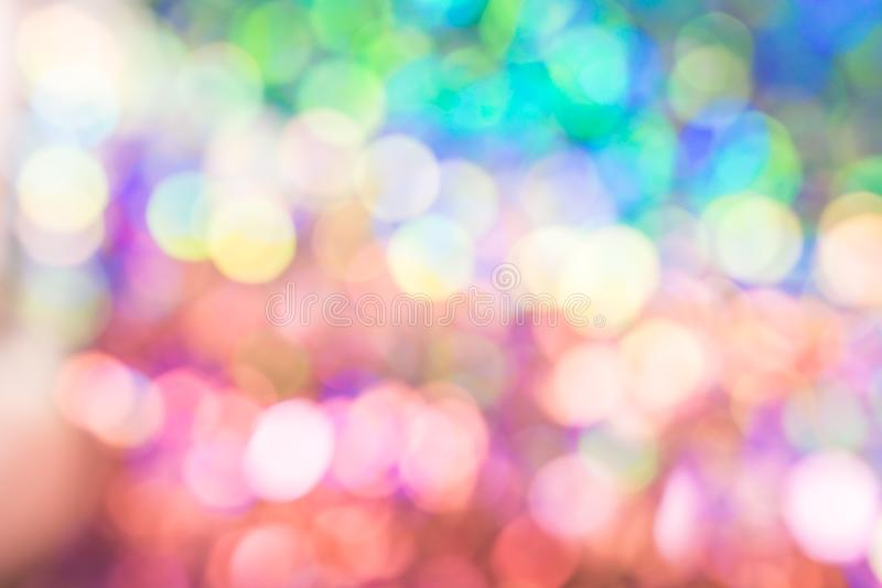 Abstract blur sequin dress color bokeh light. Abstract blur sequin dress colorful bokeh neon light. Design backdrop. Disco color stock image