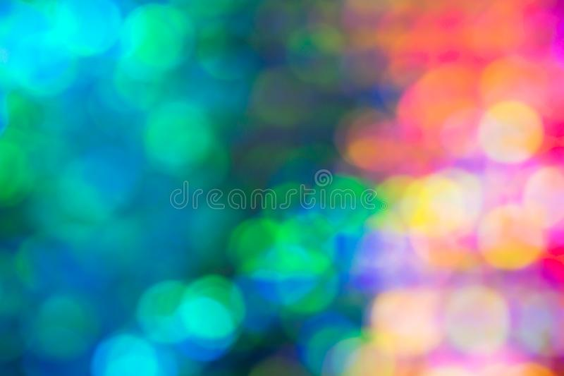 Abstract blur sequin dress color bokeh light. Abstract blur sequin dress colorful bokeh neon light. Design backdrop. Disco color royalty free stock image