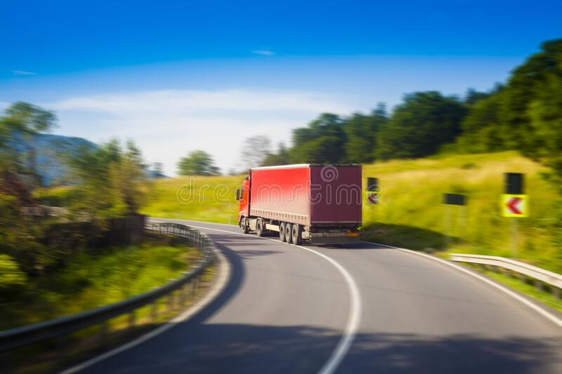 Abstract blur of truck driving on road. royalty free stock image