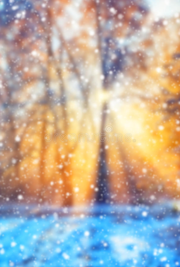 Abstract blur winter background with snow flakes. Abstract blur winter background with falling snow flakes stock photo