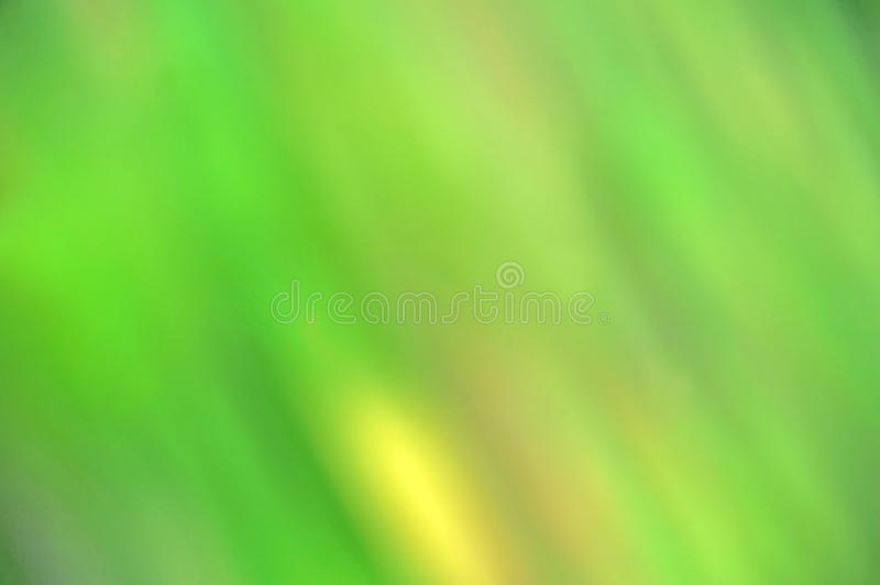 Abstract blured green background. With yellow spot stock photos