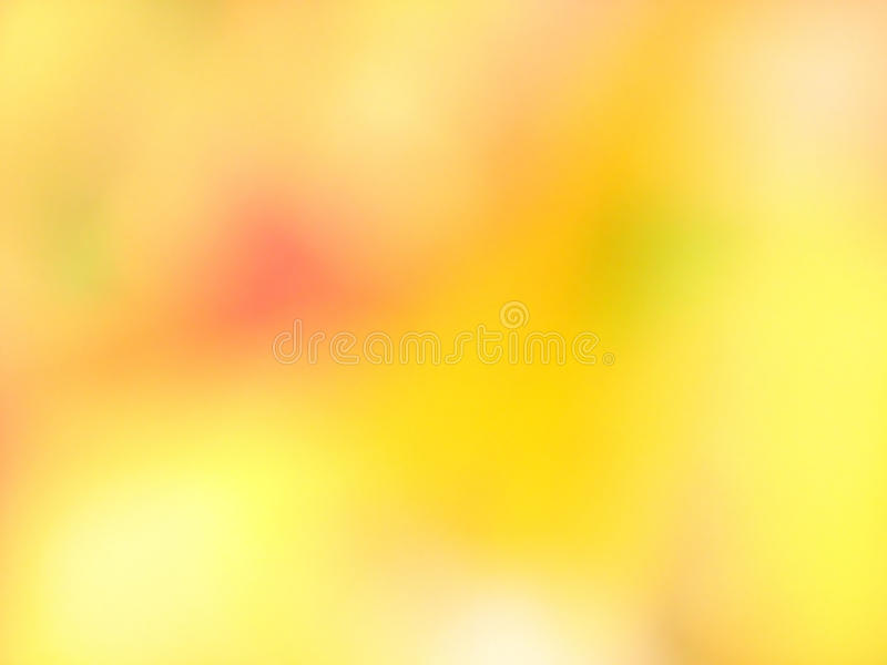 Abstract blured yellow background. With red and green spot royalty free stock photography