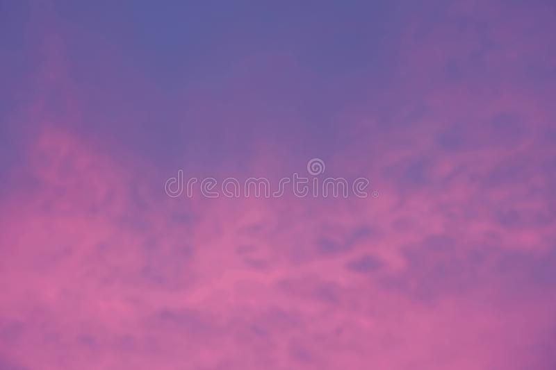 Abstract blurred background of beautiful sky with cloud. At light sunset stock photos