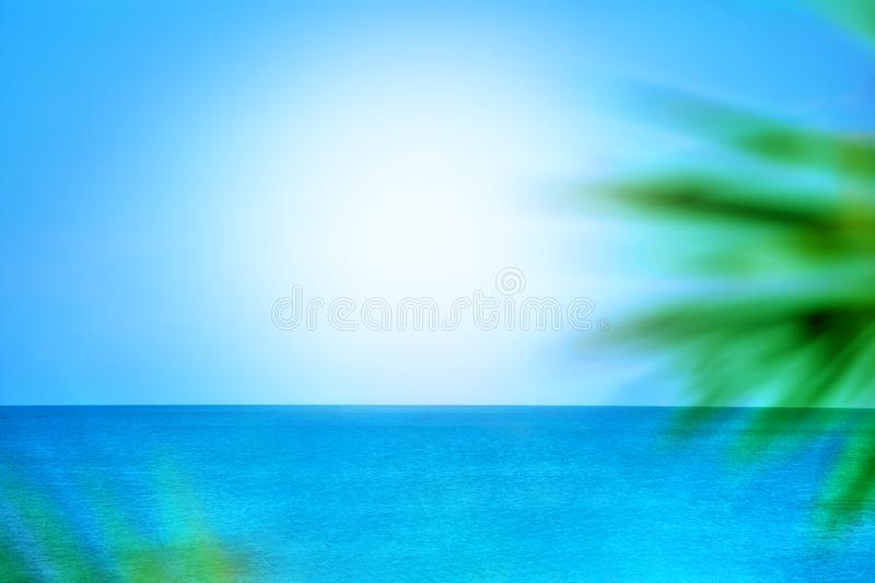Abstract blurred background, blue sea and sky, sunlight, green palm branches, design concept for travel banner royalty free stock photography