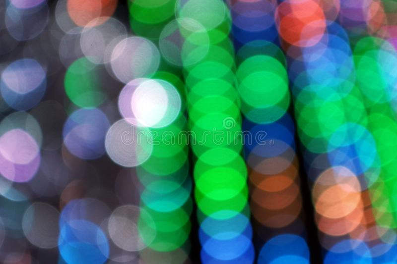 Abstract blurred background. Blurry lights. Blurry garland with multicolored lights. Multicolored toning. Christmas coming concept stock image