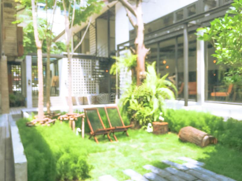 Abstract blurred background hotel luxury lobby and green garden royalty free stock image