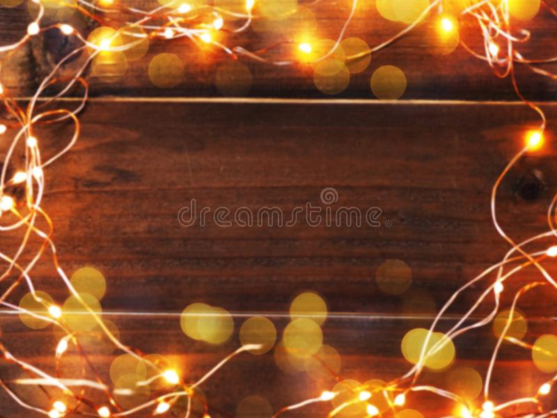 Abstract blurred background of LED lighting and wire frame on wooden grunge table with copy space. Christmas and new year stock image