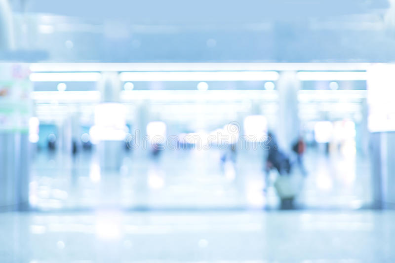 Abstract Blurred background: Office Building hallway with people. Business centre,blue tone stock image