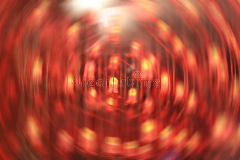 Abstract blurred background in red with radial motion blur artwork effect. With picture of led in the middle royalty free stock image