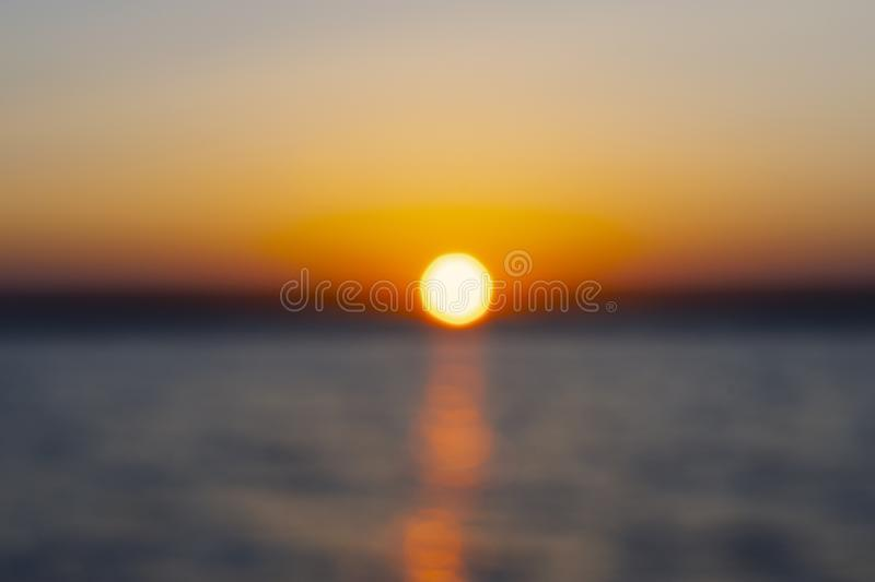 Abstract blurred background with summer lake landscape with golden sunrise. River landscape. Beautiful blur bokeh lights landscape royalty free stock images