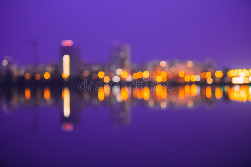 Abstract Blurred Bokeh Urban Backdrop With Reflections In Water. royalty free stock image