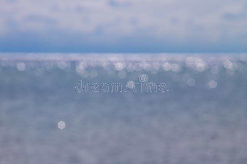Abstract blurred bokeh background of blue sea royalty free stock photography