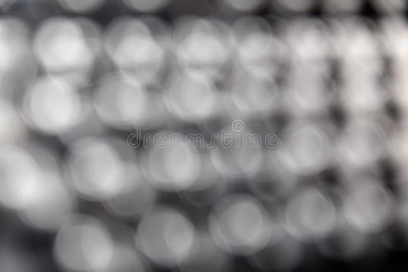 Abstract blurred bokeh background, pattern texture. White light on black stock illustration