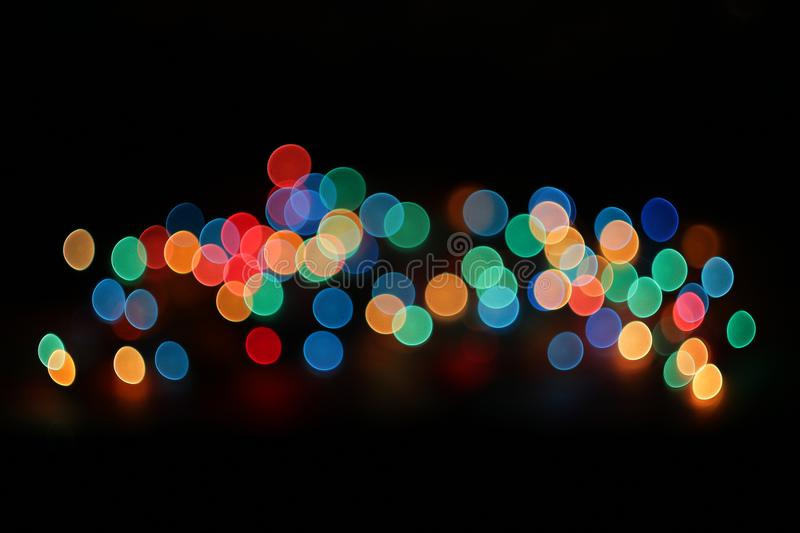 Abstract Blurred Bokeh of Different Colors on Black Background. royalty free stock image