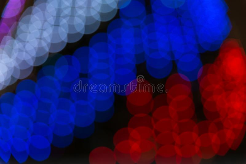 Abstract blurred bokeh texture from a variety of light circles white, blue, red by the colors of the Russian flag royalty free stock photos