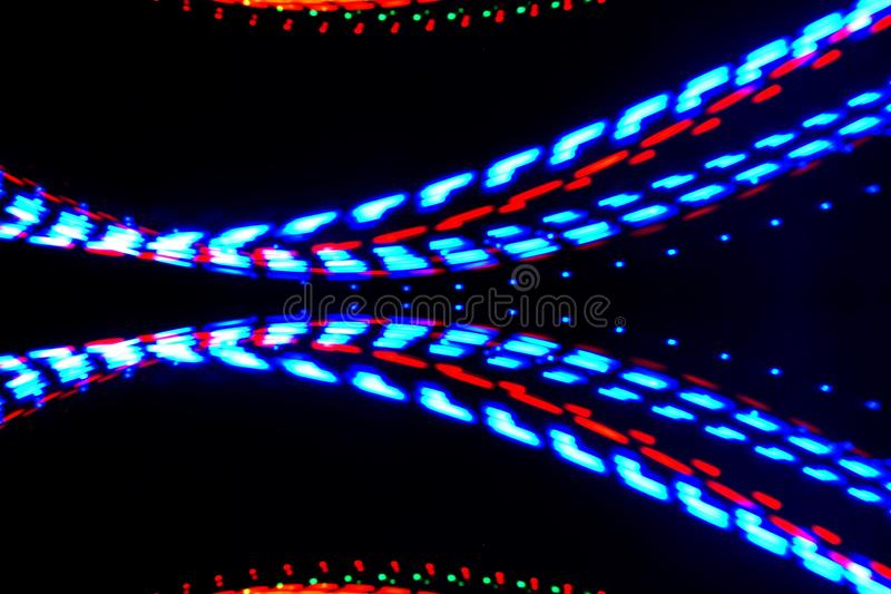 Abstract blurred bulbs light LED painting effect on black background. royalty free stock photo