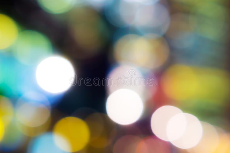 Abstract blurred color bokeh lights of night city buildings stock photography
