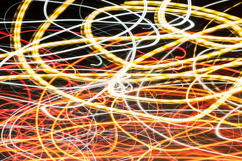 Abstract blurred colorful light effect on a black background. Long exposure photo of moving camera.  stock photography