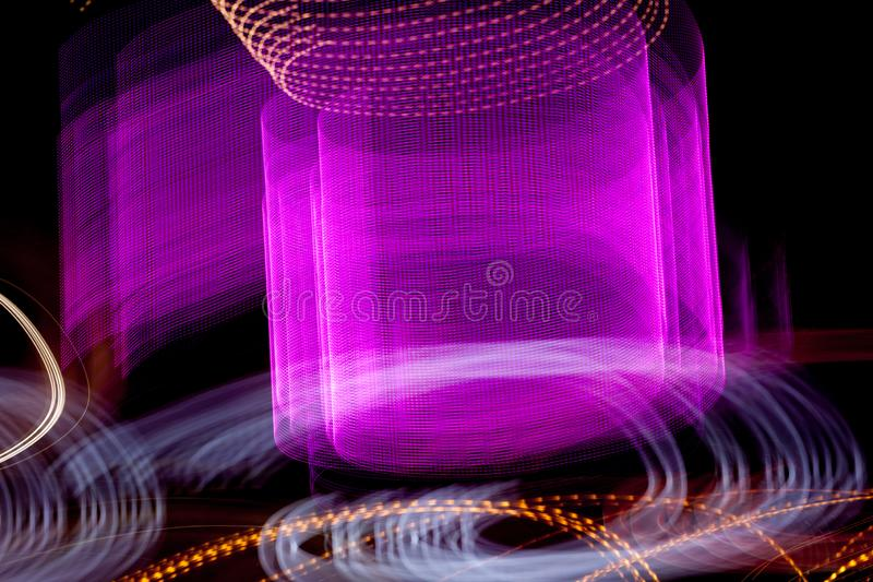 Abstract blurred colorful light effect on a black background. Long exposure photo of moving camera.  stock image